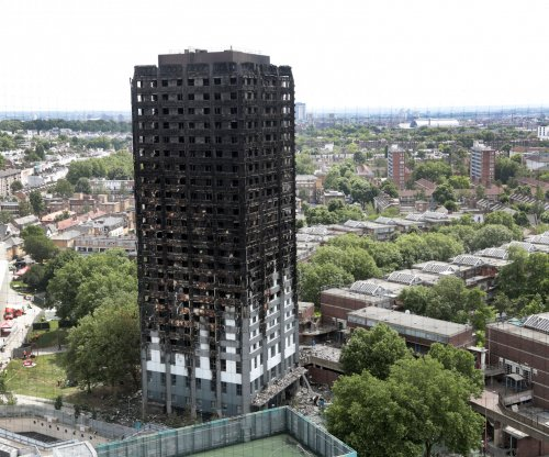 May earmarks relief money for London fire victims; death toll at 30