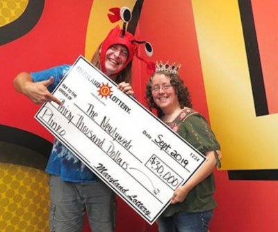 Woman waiting for a ride ends up winning $30,000 lottery jackpot
