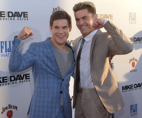 Adam Devine thinks he looks like a treasure troll next to Zac Efron