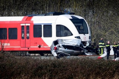 Train strikes car, two dead in Netherlands