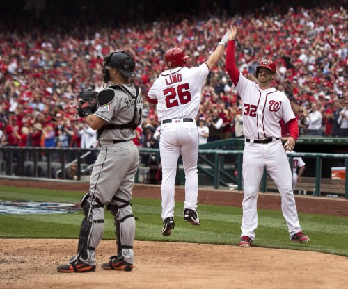 Adam Lind's pinch-hit homer lifts Washington Nationals past Miami Marlins on Opening Day