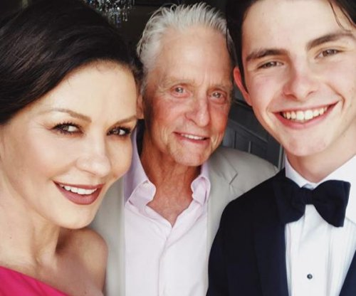 Michael Douglas, Catherine Zeta-Jones pose with son before prom