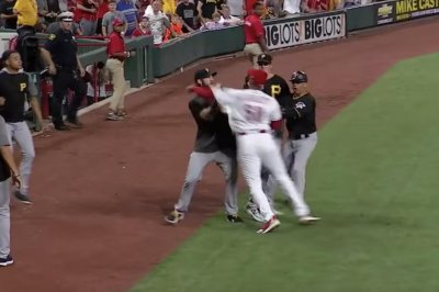 Reds' Amir Garrett throws leaping punch, sparks brawl with Pirates