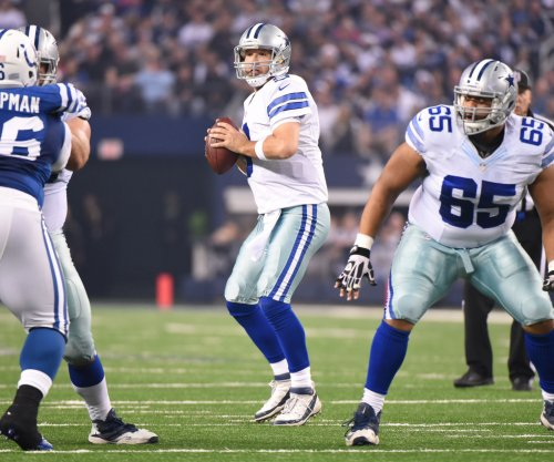 Tony Romo, Dallas Cowboys rout Indianapolis Colts, win NFC East
