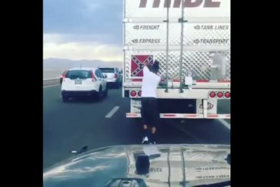 Man pulls Confederate flag from moving semi in viral video