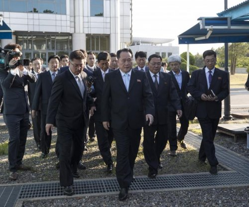 Two Koreas 'skip lunch' to discuss cooperation, exchange