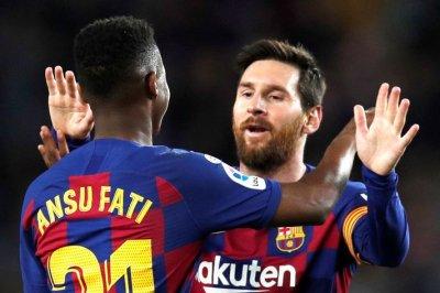 Soccer: Barcelona gives Lionel Messi's No. 10 to Ansu Fati