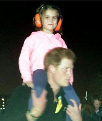 Prince Harry sweeps an adorable little girl off her feet at Invictus Games