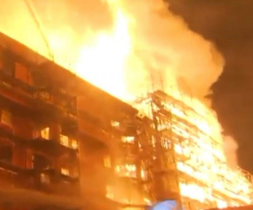 Massive fire in apartment tower under construction closes LA freeways