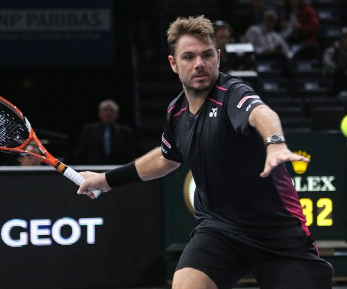 French Open: Stan Wawrinka survives; Andy Murray trails suspended match