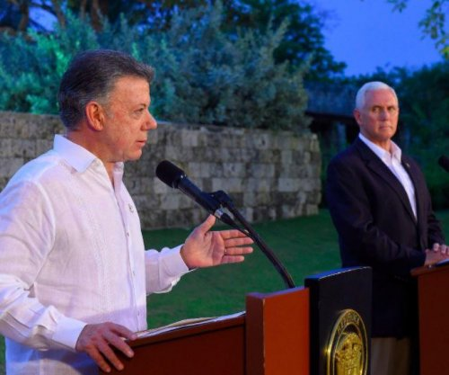 With Pence, Colombia leader urges no U.S. military action in Venezuela