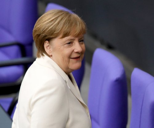 After historic delay, Merkel sworn in for 4th term as German chancellor