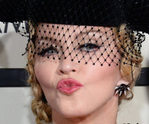 Madonna visits hospital wing her charity is paying to construct