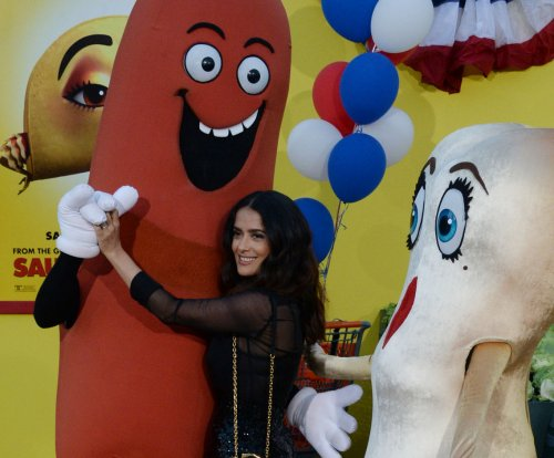 Salma Hayek gets playful at 'Sausage Party' premiere