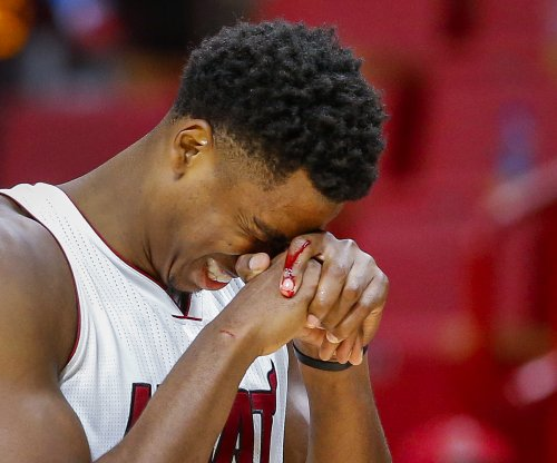 Hassan Whiteside: Bruised knee sidelines Miami Heat center for a week
