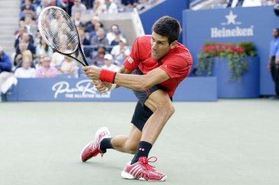 Djokovic wins three-set challenge at China Open