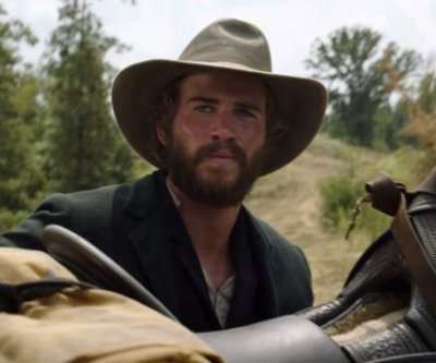 Liam Hemsworth takes on Woody Harrelson in 'The Duel' trailer