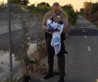 Newborn found buried alive under asphalt