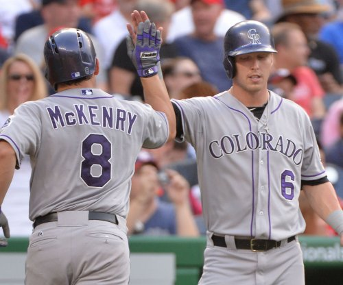 Colorado Rockies deal OF Curtis Dickerson to Tampa Bay Rays for LHP Jake McGee