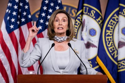 Pelosi calls for House to return this week for Postal Service vote