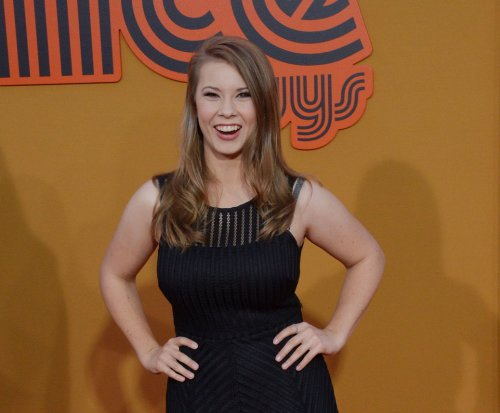 Bindi Irwin and Chandler Powell sport candy ring pops in Instagram pic