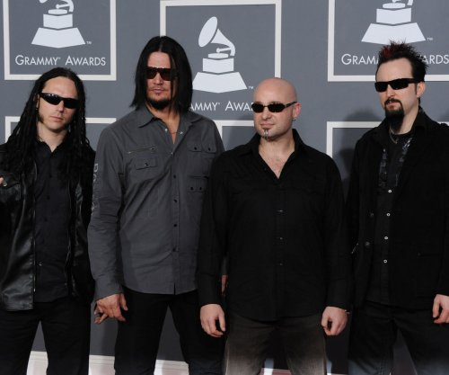 Warner Bros. pulls ad for Disturbed album after news crew shooting