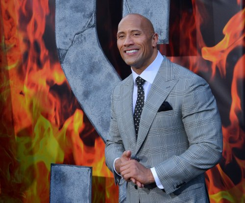 Dwayne 'The Rock' Johnson helps save abused pooch that was named after him