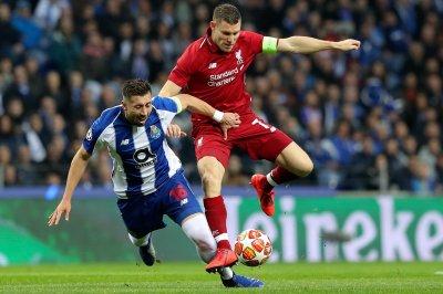 Liverpool lashes Porto, advances in Champions League