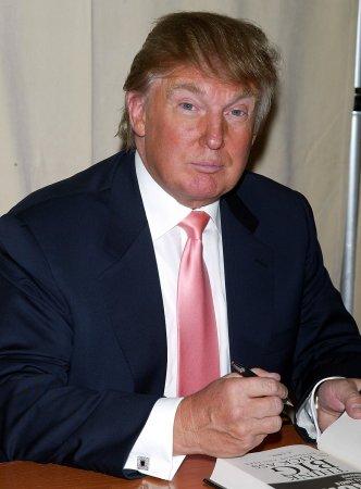 Trump flies flag in face of fee