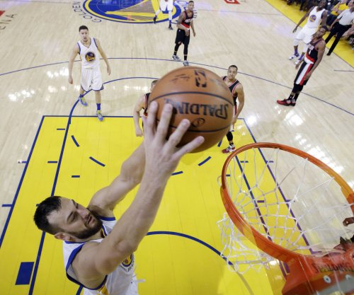 Golden State Warriors' Andrew Bogut travels, awaits MRI results