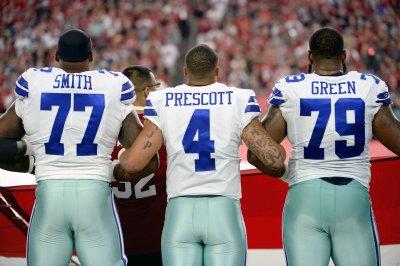 Dallas Cowboys OT Tyron Smith battling ailments, sits out practice