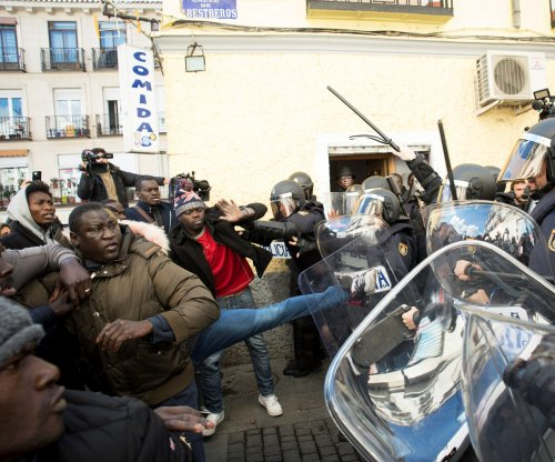 Riots hit Madrid amid outrage over death of African street vendor