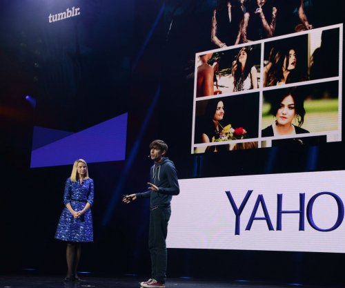 Yahoo shuts down China office, eliminates 350 workers