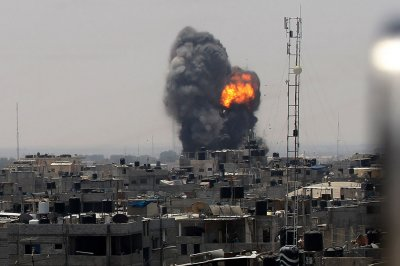 2 dead, dozen injured as Israelis, Palestinians trade airstrikes, rockets