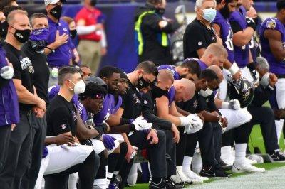 Ravens coach disciplined amid COVID-19 outbreak