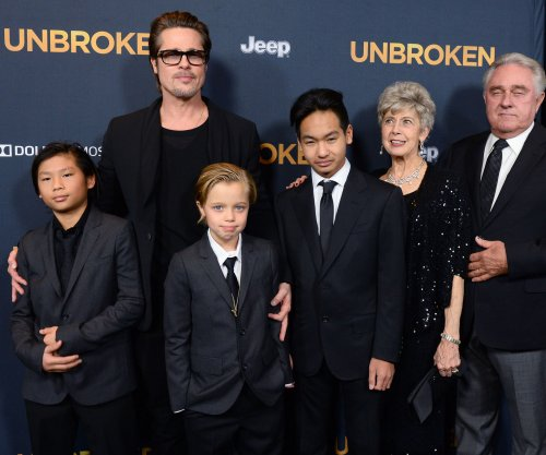 Brad Pitt and the Jolie-Pitt kids fill in for Angelina Jolie at 'Unbroken' premiere