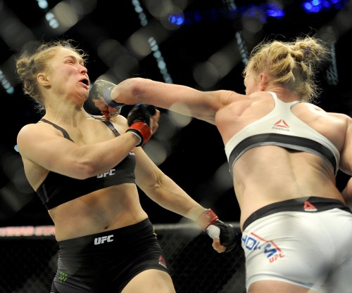 Ronda Rousey leg swept by little boy in latest fight