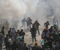 Farmers in India clash with police during protests against new laws