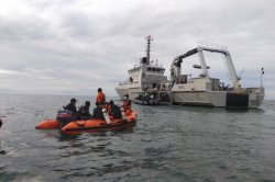Debris from crashed Indonesian plane found, including black boxes