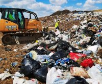 Landfill workers dig through trash to find woman's lost wallet, wedding ring