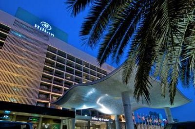 Hilton prices at $20 a share in largest hotel IPO