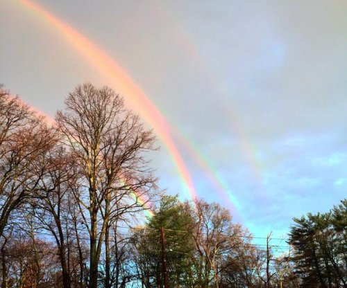 New York woman photographs ultra-rare quadruple rainbow