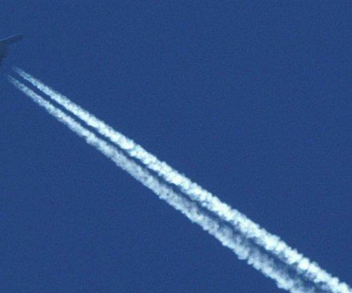 Airplanes brighten clouds