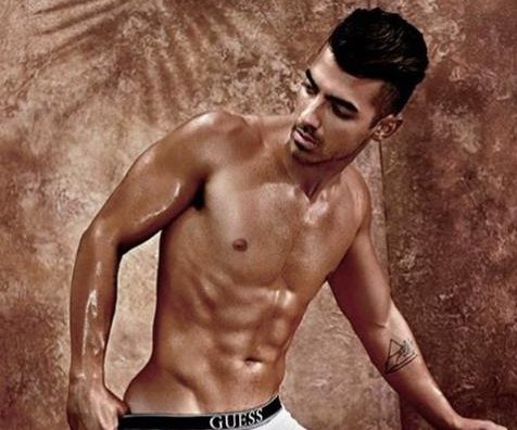 Joe Jonas strips down in Guess underwear ads