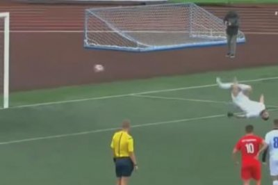 Russian soccer player scores penalty kick while doing backflip