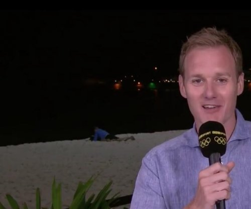 Couple 'reading a book' on beach interrupt Olympics broadcast