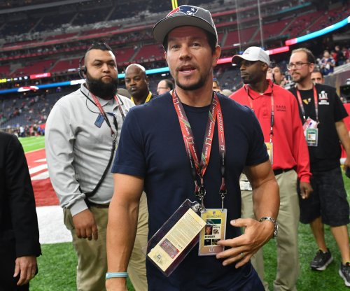 Mark Wahlberg says he left the Super Bowl early because his son was sick