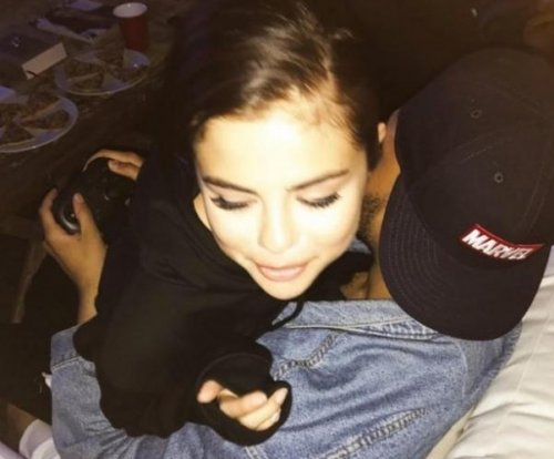 Selena Gomez snuggles The Weeknd in new photo at 'home'