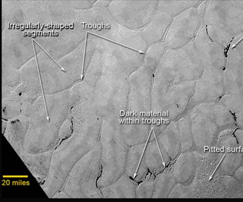 New Horizons craft sends new photos of Pluto's surface, including 'tail'