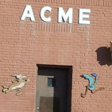 Acme building graffitied with Wile E. Coyote, Road Runner